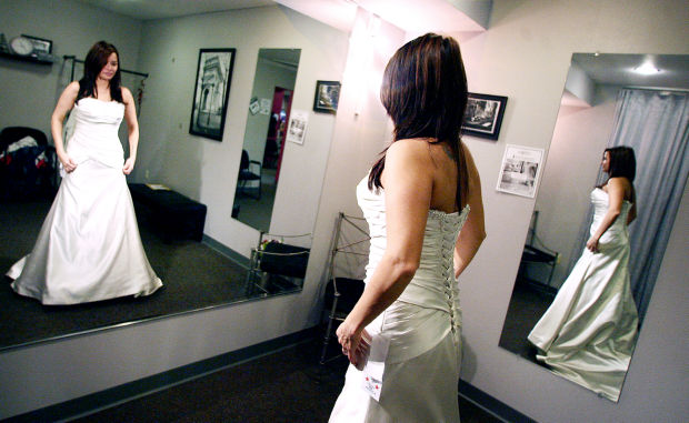 Military brides flock to shop for free gowns local for Wedding dresses la crosse wi