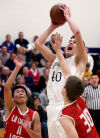 Aquinas uses stingy defense, rebounding to topple Logan