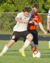 Boys soccer pulls out late tie