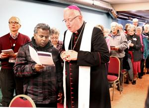 Photos: Bishop blesses warming center