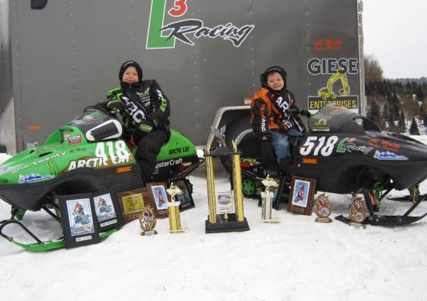 Need for speed: Brothers enjoy snowmobile racing