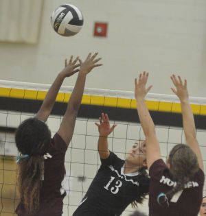 Young Timberwolves can't hold off Holmen