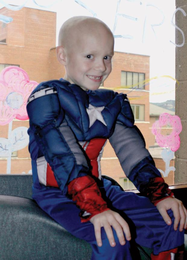 After heroic fight, 8-year-old Obi dies, surrounded by praying family