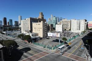 Two Building Project Would Rise on Parking Lots