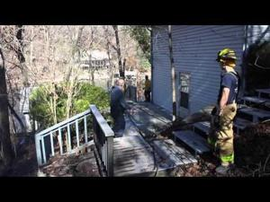 Firefighters cut a tree burning on the inside at Lake of the Ozarks