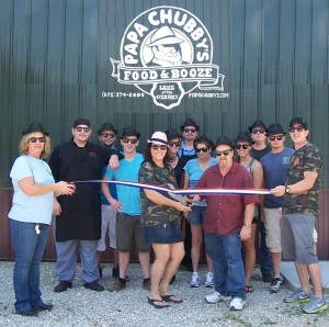 <p>Owners of Papa Chubby's Food & Booze, along with staff members, were present for the recent ribbon cutting ceremony hosted by the Lake West Chamber of Commerce.</p>