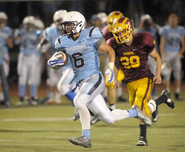 Prep football: Spartans outgun Raiders in annual rivalry game