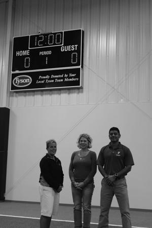 Tyson fresh meats inc funds purchase of scoreboard at for Tyson motors service hours