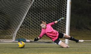 Twice is nice: Tokay's Katie Price started for two teams this winter — goalkeeper in soccer and forward in basketball