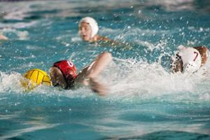 Flames sweep Trojans in water polo, stay perfect in league standings