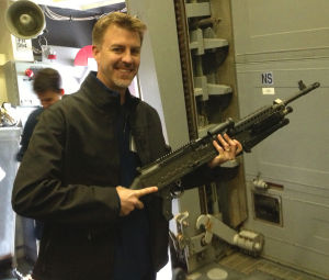 Two Lodi-area Men Spend Day On Destroyer To Learn What Navy Life Is Like: Ryan Sherman holds a powerful weapon used by Navy personnel, on Dec. 18, 2012.  - Photo by Courtesy Photograph