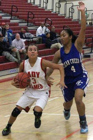 Girls basketball: Late rally falls short as Flames suffer first league setback