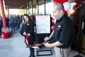 BevMo! Opens In Lodi : Store manager Javier Martinez, right, cuts a ribbon held by Jill Doe, district manager, during the opening ceremony of BevMo! on Kettleman Lane in Lodi on Friday, Nov. 9, 2012.  - Photo by Dan Evans/News-Sentinel