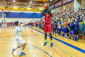 Boys basketball: Flames top Tigers