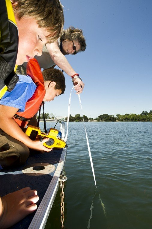 Kids from Outdoor Adventure Club help measure clarity at Lodi Lake