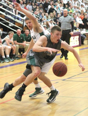 Boys Basketball: Hawks Outlast Falcons In Overtime, Advance To Section Championship : Michael Meserole of the Liberty Ranch Hawks outmaneuvers a Colfax Falcons defender as he heads to the paint at Tokay High School on Wednesday, Feb. 27, 2013. The Hawks beat the Falcons 64-59 in overtime to advance to the Sac-Joaquin Section Division IV championship against the Summerville Bears of Tuolumne at Sleep Train Arena in Sacramento on Saturday, March 2, 2013.