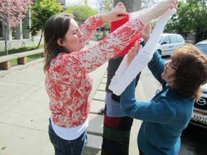 Crafty volunteers yarnbomb Lodi library