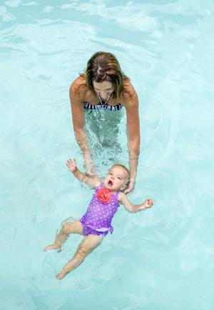 Julie Schiess teaches the youngest swimmers how to stay afloat