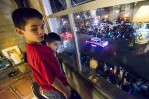 Parade Lights Up Lodi: Isaac Mendonca, 5, back, and Joey Mendoca, 7, watch the 17th annual Parade of Lights from the Woolworth's Building on Thursday, Dec. 6, 2012.  - Dan Evans/News-Sentinel