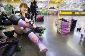 Reporter Skates After Her Derby Girl Dreams : News-Sentinel reporter Sara Jane Pohlman pulls on her roller skate before practicing with the Port City Roller Girls roller derby team at the San Joaquin County Fairgrounds on Thursday, Feb. 7, 2013.  - Dan Evans/News-Sentinel