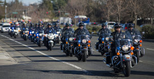 Fallen Galt Police Officer Kevin Tonn Laid To Rest : Dozens of motor officers lead a processional to the graveside service of Galt Police Officer Kevin Tonn on Monday, Jan. 21, 2013.  - Photo by Dan Evans/News-Sentinel