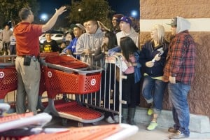 Lodi Shoppers Brave Black Friday Sales : Target employee Lupe Munoz instructs the first group of shoppers to enter Target during the stores early Black Friday sale in Lodi on Thursday, Nov. 22, 2012.