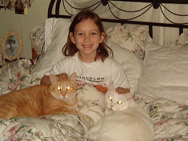 Grand daughter Sierra takes Cats for a Nap.....