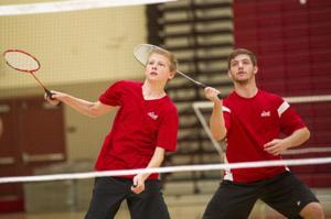Boys badminton: Flames sweep Tigers