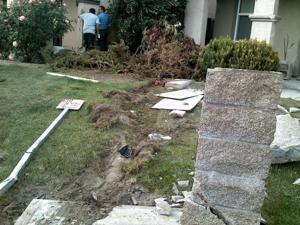 SUV hits concrete street sign, crashes into couple's home in Lodi