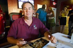 Lodi leaders try — and fail — to eat 6 pounds of beef and beans at sports grill's opening