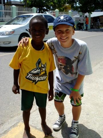 Taylor and a new Thunder fan in Roatan, Honduras