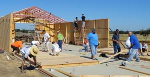 Mormon volunteers help build new barn