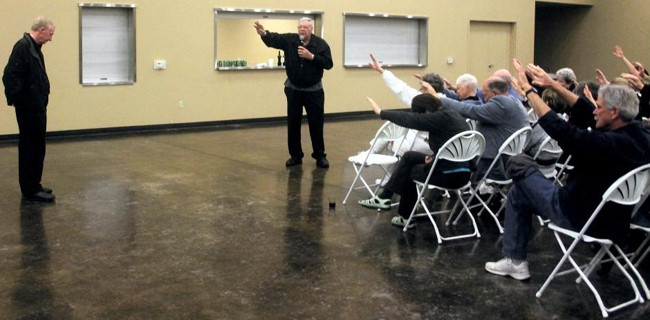 Father Michael Kelly speaks to supporters in Lockeford