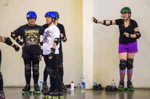 "Reporter Skates After Her Derby Girl Dreams : News-Sentinel reporter Sara Jane Pohlman steadies herself with the wall as other roller derby ""noobies"" practice stopping.  - Dan Evans/News-Sentinel"