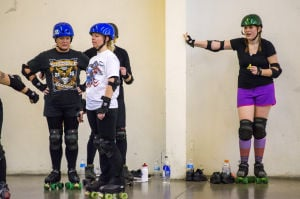 "Reporter Skates After Her Derby Girl Dreams : News-Sentinel reporter Sara Jane Pohlman steadies herself with the wall as other roller derby ""noobies"" practice stopping.  - Photo by Dan Evans/News-Sentinel"