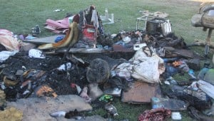 Lodi Couple Homeless After Fire Destroys Home: Debris is spread across the front yard of Joanna and Juan Ruiz's residence in south Lodi on Sunday, Nov. 11, 2012. The house off Lower Sacramento Road, south of Century Boulevard, was destroyed by fire Saturday, Nov. 10, 2012, while the couple was at a family reunion in Lathrop.  - Photo by Ross Farrow/News-Sentinel