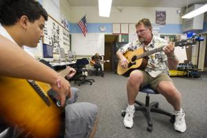 Liberty High School teacher Brad Owings boosts students' self-esteem with guitar classes