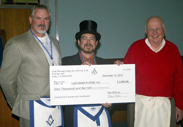 Lodi Masonic Lodge presents check to Lodi Adopt-A-Child
