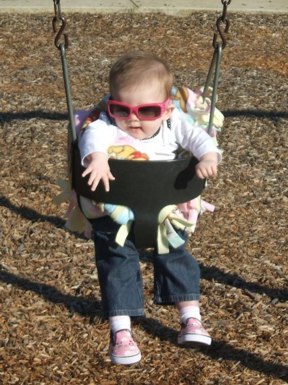 Emma's First Swing Ride