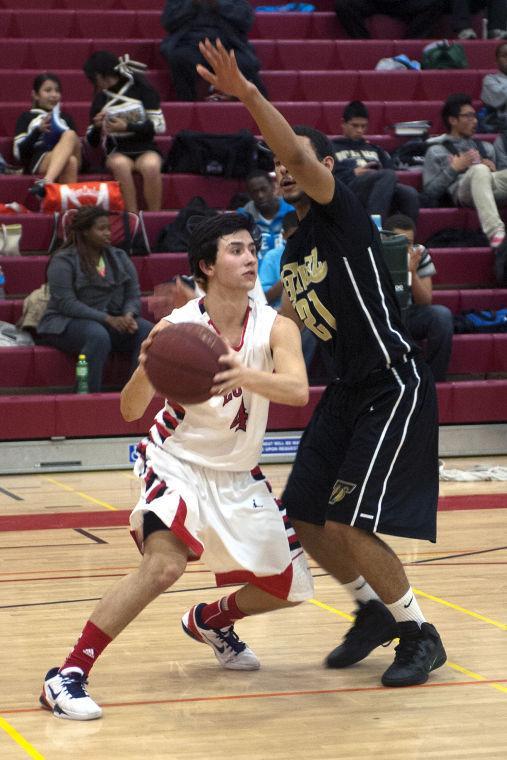 Boys basketball: Flames topple Titans