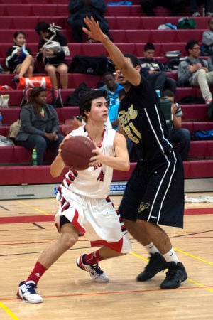 Boys basketball: Flames topple Titans