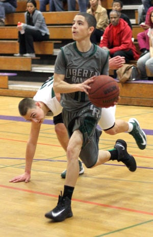 Boys Basketball: Hawks Outlast Falcons In Overtime, Advance To Section Championship : Zack Justice of the Liberty Ranch Hawks heads for the paint as a Colfax Falcons defender gets tripped up at Tokay High School on Wednesday, Feb. 27, 2013. The Hawks beat the Falcons 64-59 in overtime to advance to the Sac-Joaquin Section Division IV championship against the Summerville Bears of Tuolumne at Sleep Train Arena in Sacramento on Saturday, March 2, 2013.