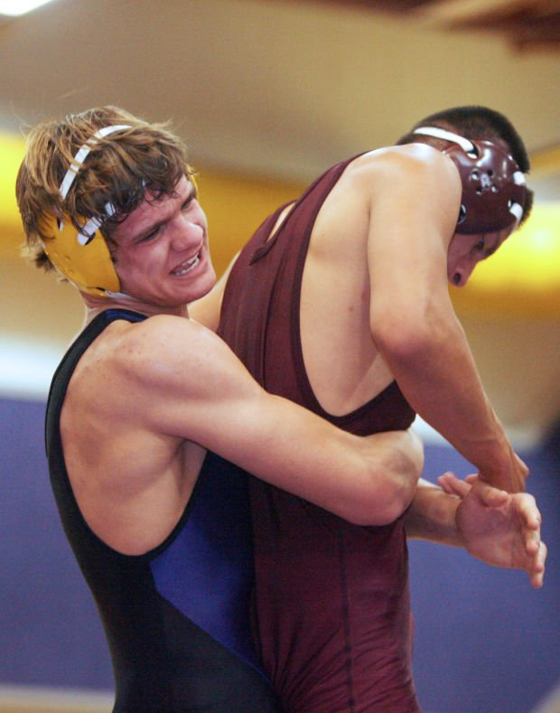 Wrestling: Tigers top Vikings
