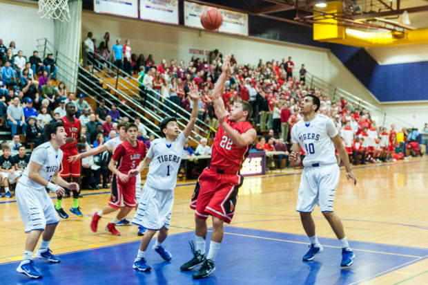 Boys basketball: Flames top Tigers