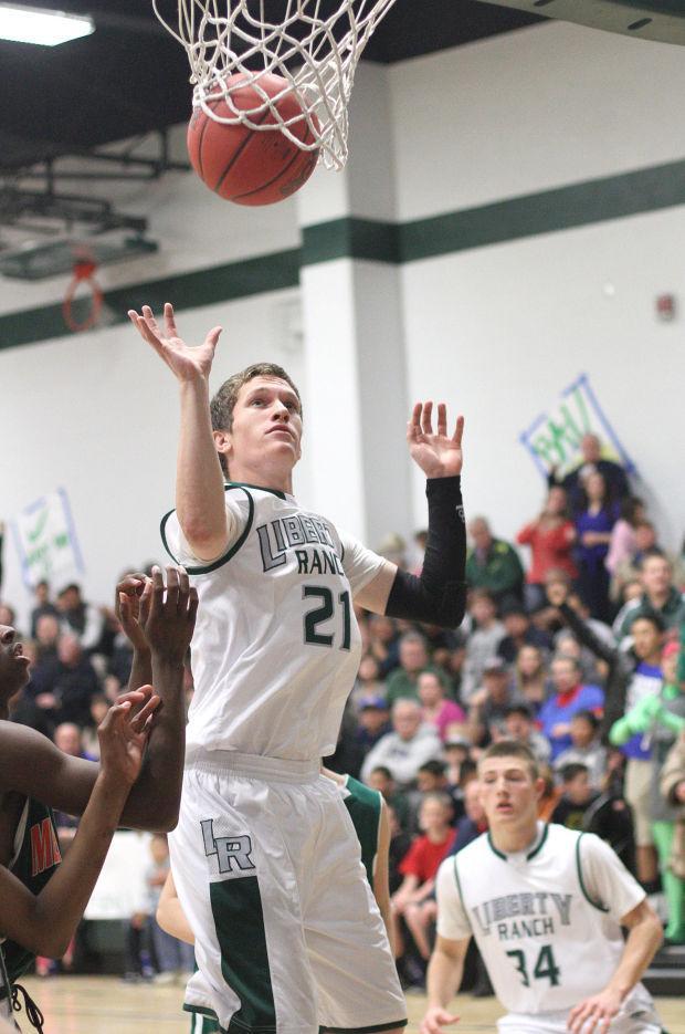 Boys basketball: Hawks too hot to handle