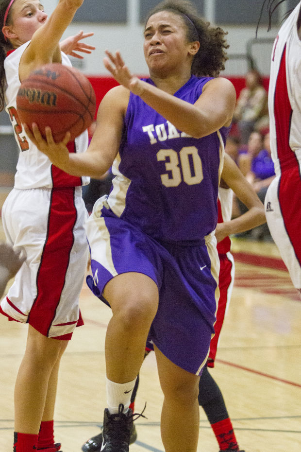 Girls basketball: Trojans trip up Tigers