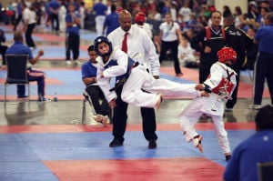 Zachary Paustenbach perseveres in golden pursuit in taekwondo