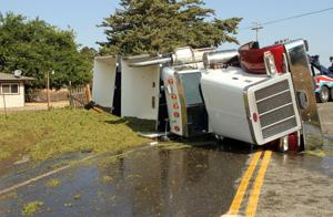 Semi-truck hauling grapes overturns on off-ramp near Liberty Road