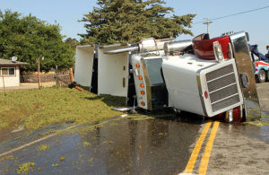 Semi-truck hauling grapes overturns at on-ramp near Liberty Road