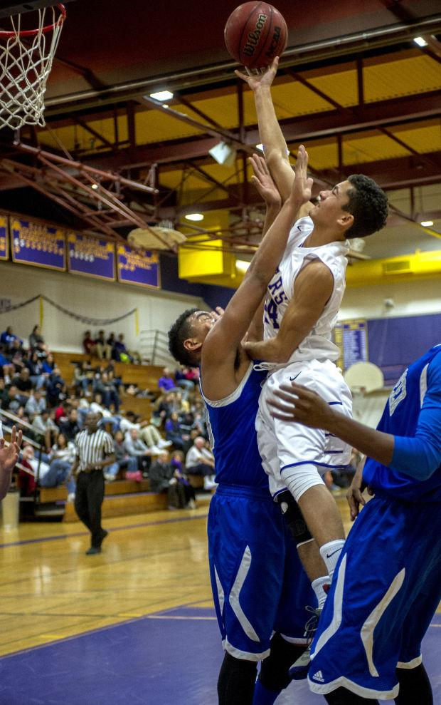 Boys basketball: Tigers can't hold on, lose to Bruins